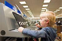 Little boy is testing a laptop computer Stock Photo - Premium Royalty-Freenull, Code: 649-03487423