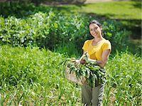 farmhand (female) - Woman with freshly picked veg in basket Stock Photo - Premium Royalty-Freenull, Code: 649-03487543