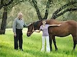 Grandad and granddaughter with horse Stock Photo - Premium Royalty-Free, Artist: Blend Images, Code: 649-03487589