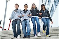 preteen girl boyfriends - Group of Friends Walking Down Stairs, Outdoors Stock Photo - Premium Rights-Managednull, Code: 700-03490342