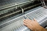 Weaving mill, machinist manually checking thread tension on a loom Stock Photo - Premium Royalty-Free, Artist: Masterfile, Code: 632-03500474