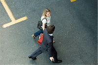 person walking on parking lot - Couple walking together across parking lot, woman carrying shopping bags Stock Photo - Premium Royalty-Freenull, Code: 632-03500883