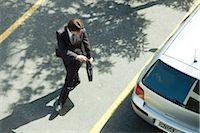 person walking on parking lot - Man locking car doors using key remote as he walks away Stock Photo - Premium Royalty-Freenull, Code: 632-03500931
