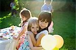Young friends embracing at outdoor party, portrait Stock Photo - Premium Royalty-Freenull, Code: 632-03500993