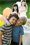 Young friends together at outdoor party, portrait Stock Photo - Premium Royalty-Freenull, Code: 632-03500996
