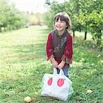 Little Girl in Apple Orchard Stock Photo - Premium Rights-Managed, Artist: Michael Filonow, Code: 700-03502976