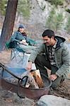 Couple around Campfire, Truckee, near Lake Tahoe, California, USA Stock Photo - Premium Rights-Managed, Artist: Ty Milford, Code: 700-03503044