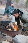 Couple Sitting around Campfire, Truckee, near Lake Tahoe, California, USA Stock Photo - Premium Rights-Managed, Artist: Ty Milford, Code: 700-03503045
