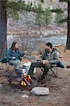 Couple Sitting Around Campfire, Truckee, near Lake Tahoe, California, USA Stock Photo - Premium Rights-Managed, Artist: Ty Milford, Code: 700-03503046