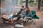 Couple Sitting Around Campfire, Truckee, near Lake Tahoe, California, USA Stock Photo - Premium Rights-Managed, Artist: Ty Milford, Code: 700-03503049
