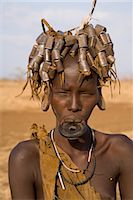 Portait of a Mursi girl with clay lip plate, and hairstyle that indicates she is going through puberty,The Mursi Hills, Mago National Park, Lower Omo Valley, Ethiopia, Africa Stock Photo - Premium Rights-Managednull, Code: 841-03505106