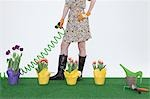 Woman with hose and flowers on artificial turf Stock Photo - Premium Royalty-Free, Artist: Jerzyworks, Code: 614-03506655