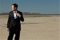 sweaty businessman - Businessman in desert Stock Photo - Premium Royalty-Freenull, Code: 614-03507056