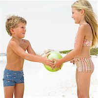 Boy and girl (6-8) on beach playing with ball Stock Photo - Premium Rights-Managednull, Code: 841-03507729