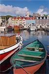 Colourful boats and picturesque gabled buildings along the quayside in Vestaravag harbour, Torshavn, Streymoy, Faroe Islands (Faroes), Denmark, Europe.