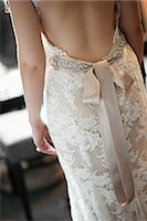 special moment - Close-Up of Bride Wearing Wedding Gown Stock Photo - Premium Rights-Managednull, Code: 700-03508822