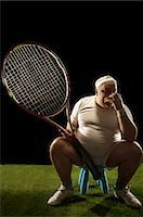 fat man exercising - Tennis player with large racquet sitting Stock Photo - Premium Royalty-Freenull, Code: 649-03511270