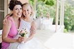 Woman hugging flower girl Stock Photo - Premium Royalty-Free, Artist: Glowimages               , Code: 635-03515423
