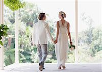 Bride and groom holding hands Stock Photo - Premium Royalty-Freenull, Code: 635-03515461