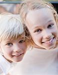 Smiling girl and boy Stock Photo - Premium Royalty-Free, Artist: Blend Images, Code: 635-03515522