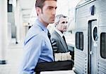 Businessmen waiting for train in train station Stock Photo - Premium Royalty-Freenull, Code: 635-03515543