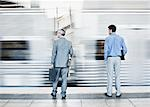 Businessmen watching speeding train Stock Photo - Premium Royalty-Freenull, Code: 635-03515618