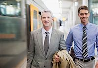 platform - Businessmen walking on train platform Stock Photo - Premium Royalty-Freenull, Code: 635-03515619