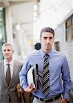 Businessmen walking on train platform Stock Photo - Premium Royalty-Freenull, Code: 635-03515623