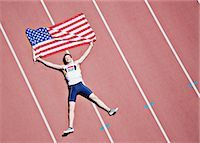 pennant flag - Runner laying on track with American flag Stock Photo - Premium Royalty-Freenull, Code: 635-03515634