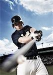 Baseball player swinging baseball bat Stock Photo - Premium Royalty-Free, Artist: Kevin Dodge, Code: 635-03515635