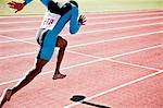 Runner sprinting on track Stock Photo - Premium Royalty-Freenull, Code: 635-03515637