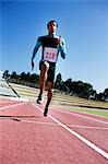 Runner sprinting on track Stock Photo - Premium Royalty-Freenull, Code: 635-03515680