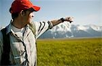 Man pointing in remote valley Stock Photo - Premium Royalty-Free, Artist: RAW FILE, Code: 635-03515819