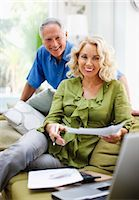 Couple working together in living room Stock Photo - Premium Royalty-Freenull, Code: 635-03515896