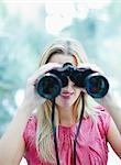 Woman using binoculars Stock Photo - Premium Royalty-Free, Artist: Ikon Images, Code: 635-03515921