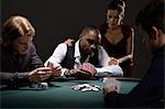 People playing poker in casino Stock Photo - Premium Royalty-Free, Artist: Tom Collicott, Code: 635-03515969