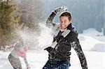 Couple having snowball fight Stock Photo - Premium Royalty-Free, Artist: Blend Images, Code: 635-03516051