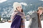 Couple holding hands in snow Stock Photo - Premium Royalty-Free, Artist: Blend Images, Code: 635-03516064