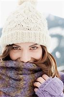 Woman in cap, scarf and gloves Stock Photo - Premium Royalty-Freenull, Code: 635-03516066