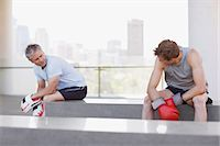 Boxer and coach resting after training Stock Photo - Premium Royalty-Freenull, Code: 635-03516253