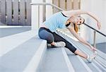 Woman stretching on stairs before exercise Stock Photo - Premium Royalty-Free, Artist: Cultura RM, Code: 635-03516279