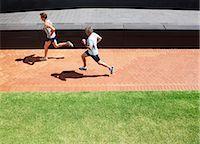 Men running on brick sidewalk Stock Photo - Premium Royalty-Freenull, Code: 635-03516310