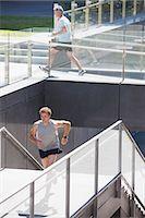 Men running in urban setting Stock Photo - Premium Royalty-Freenull, Code: 635-03516312