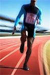 Runner sprinting on track Stock Photo - Premium Royalty-Freenull, Code: 635-03516321