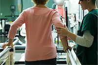 rehabilitation - Patient undergoing rehabilitation walking exercises with assistance from physical therapist Stock Photo - Premium Royalty-Freenull, Code: 632-03516717