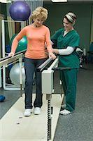 rehabilitation - Woman undergoing post-surgery rehabilitation exercises to regain ability to walk Stock Photo - Premium Royalty-Freenull, Code: 632-03516727