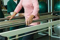 rehabilitation - Patient undergoing post-surgery rehabilitation exercises to regain ability to walk Stock Photo - Premium Royalty-Freenull, Code: 632-03516761