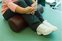 rehabilitation - Using exercise cushion for leg stretch exercise Stock Photo - Premium Royalty-Freenull, Code: 632-03516784