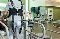 rehabilitation - Man exercising on treadmill with assistance of rehabilitation harness supporting body weight Stock Photo - Premium Royalty-Freenull, Code: 632-03516786