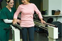 rehabilitation - Woman undergoing post-surgery rehabilitation exercises to regain ability to walk Stock Photo - Premium Royalty-Freenull, Code: 632-03516801